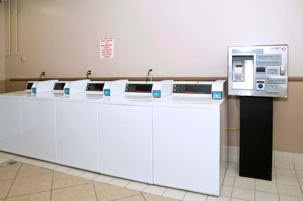 Used card or coin operated laundry machines